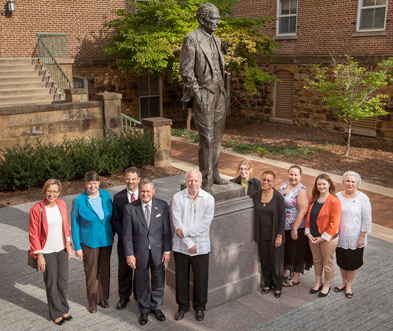 Board members and staff at the Fulbright Statue