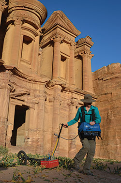 Eileen Ernenwein (left) uses ground-penetrating radar to image the subsurface in front of the Monastery at Petra, Jordan. Caitlin Stevens