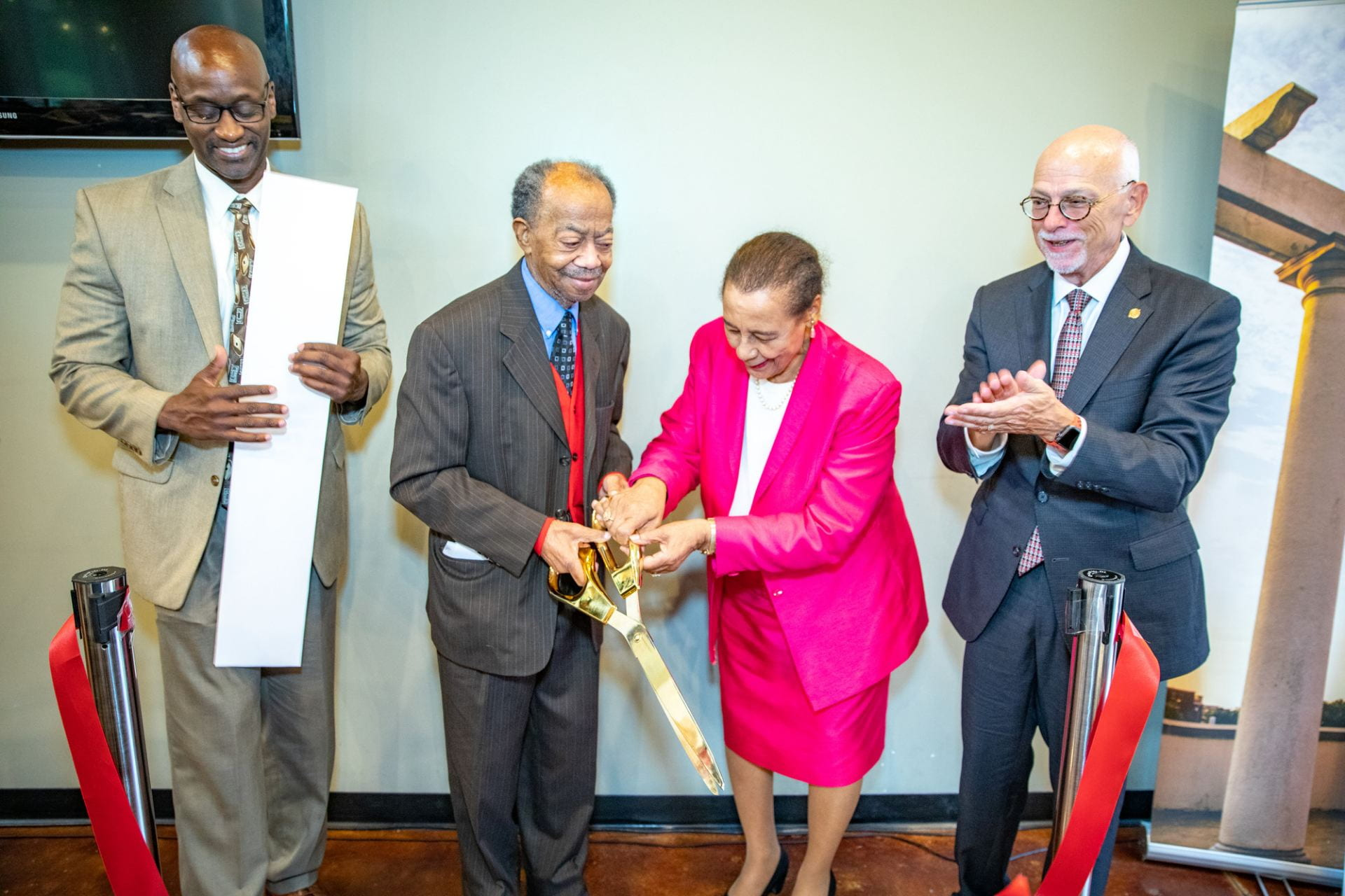 Dedication ribbon cutting
