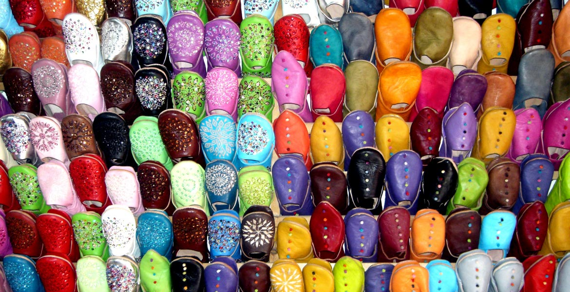A rack of slippers at a Moroccan market; photo courtesy of Tom Paradise