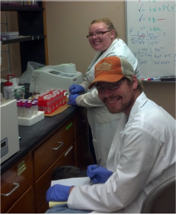 REU student Scott Hamby (bottom) running nutrient analyses on a spectrophotometer