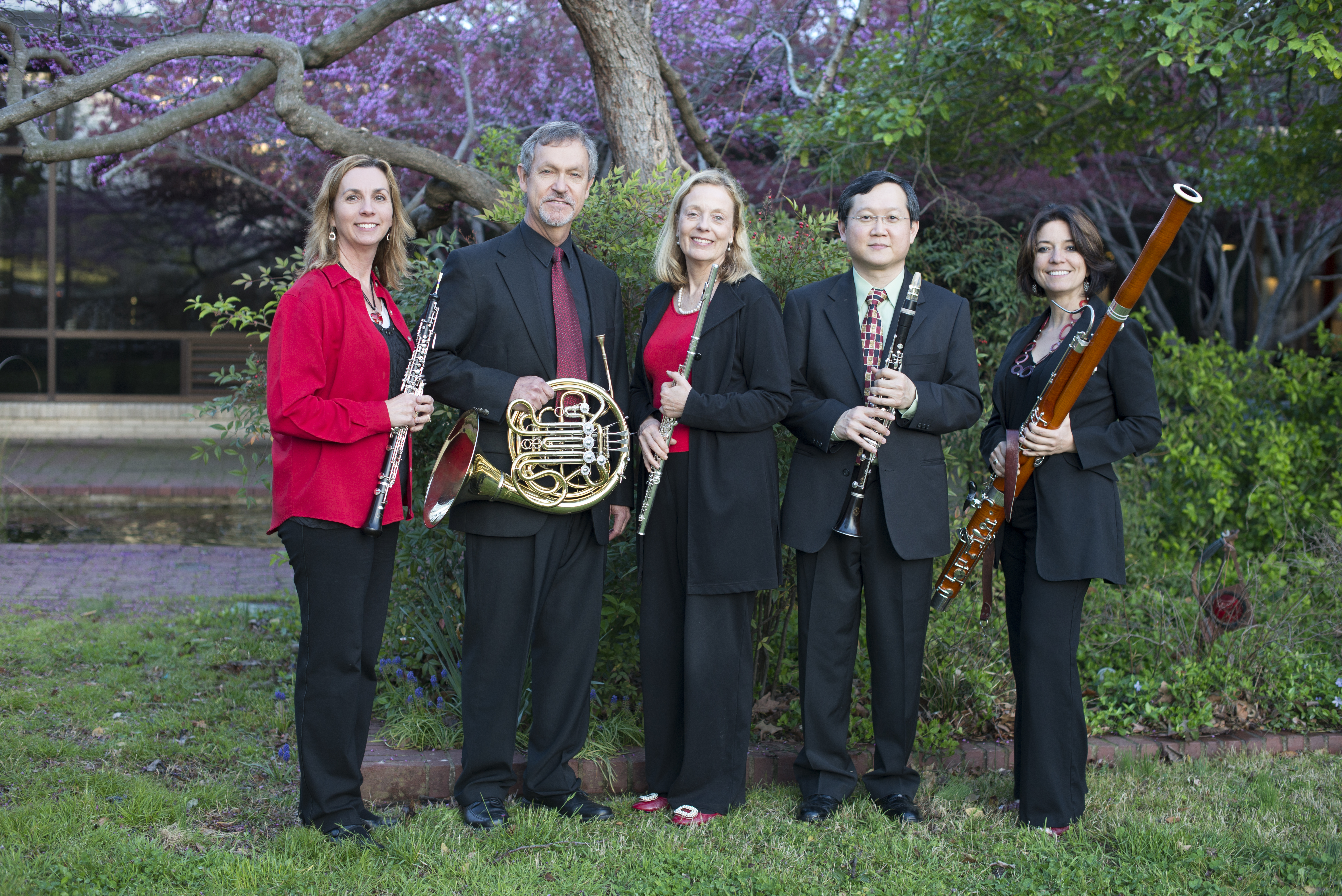 Members of the Lyrique Quintette posing with their instruments outside of the music building