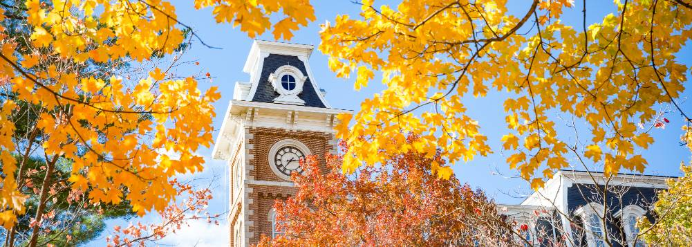 Old Main tower in the fall