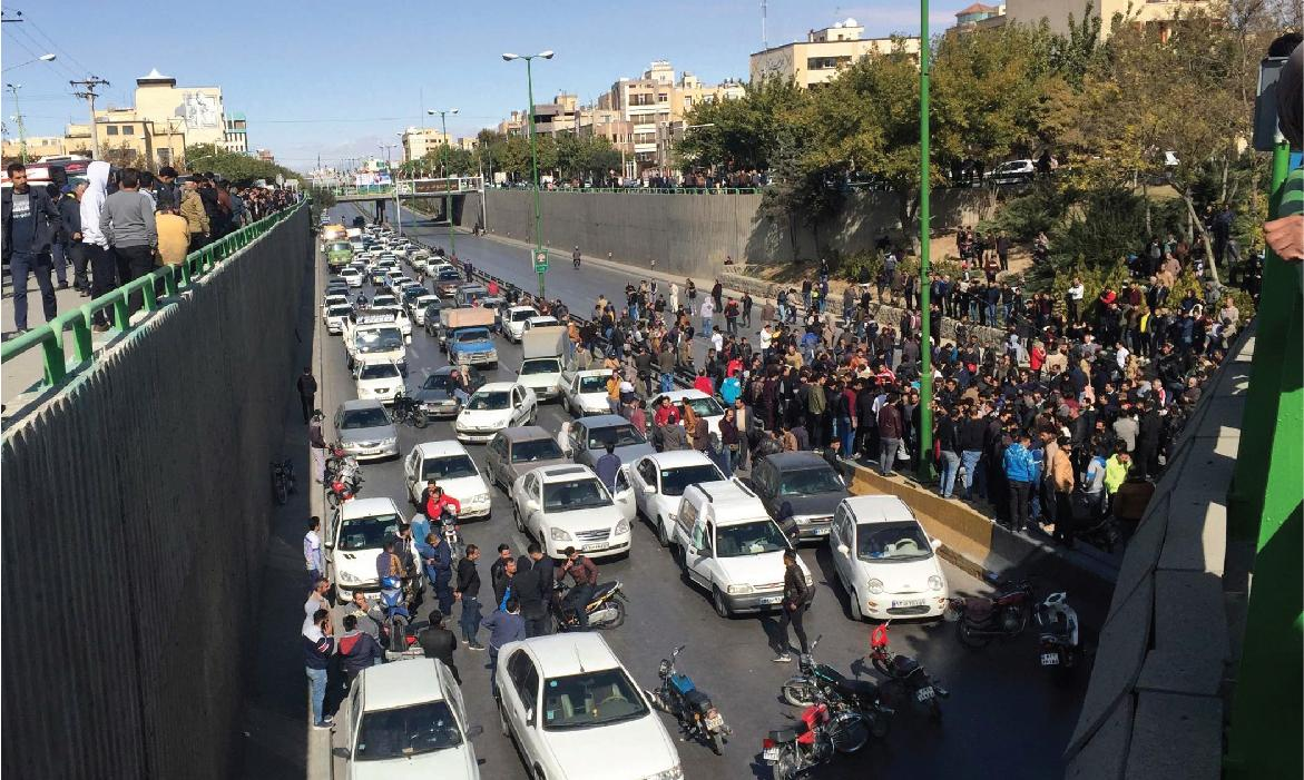 Image of crowd gathered on freeway, impeding traffic to protest rise in petrol prices (Iran, 2019)
