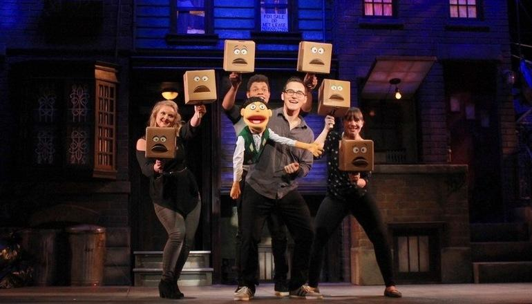 Students acting in Avenue Q play.